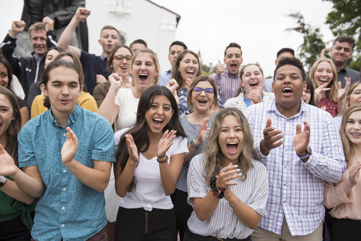 Students cheering in front of the chapel